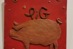 pig-brown-on-red