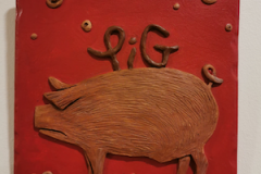 pig-brown-on-red